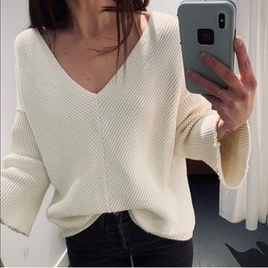 Free people sweater with raw hem